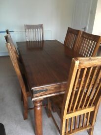 Wooden 6 seater dining table and chairs