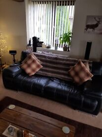 Good condition black leather sofa
