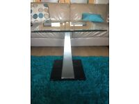Glass square table with chrome and black base