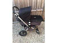 Bugaboo pram frame, carrycot and push chair in charcoal and black + accessories