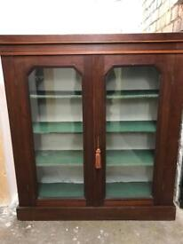 Shelving unit with lockable glass doors