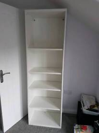 Large white ikea shelving unit