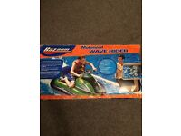 New in box motorized wave rider