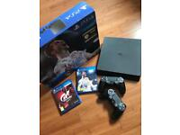 Slim PlayStation 4 with 2 games and 2 controllers