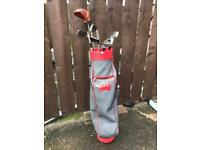 Vintage looking golf bag, clubs and balls