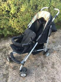 Mothercare black & coloured underhood double front & back buggy