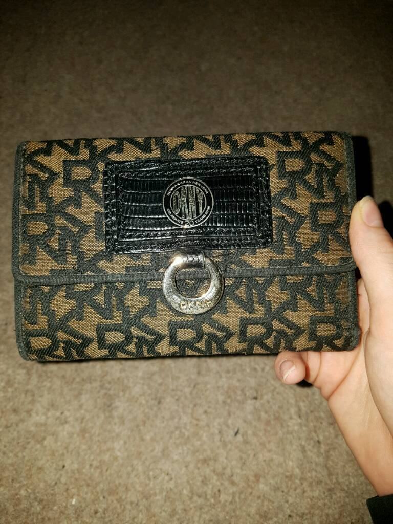 Genuine DKNY pursein Aylesford, KentGumtree - Genuine DKNY purse. Black leather with brown print. Used only a few times, great condition