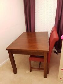 Solid Wood Table with Red Chairs