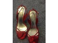 Red monsoon heels