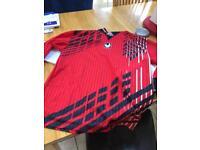 Red football shirts