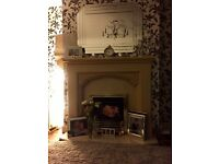 Marble fire surround and hearth in oatmeal beige