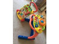 Set of 2 musical baby walkers in excellent condition