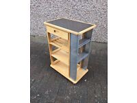 Kitchen storage unit on casters, with shelves, a drawer and a stainless steel top