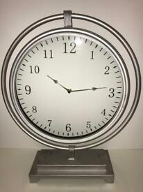 Silver round hanging mantle clock