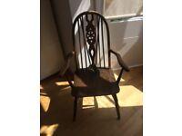 Antique solid wooden armchair