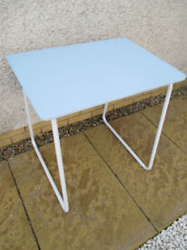 Lovely unusual 'school-style' desk. Table with white metal base, blue wood top. Shop cafe bar prop