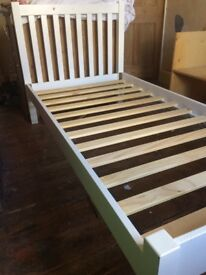 White solid wood single bed - John Lewis. High headboard, solid frame and slats. Good condition.
