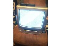 OLD STYLE PORTABLE TV/VHS PLAYER WITH REMOTE CONTROL (DONT THINK VIDEO WORKS) WILL NEED FREEVIEW BOX