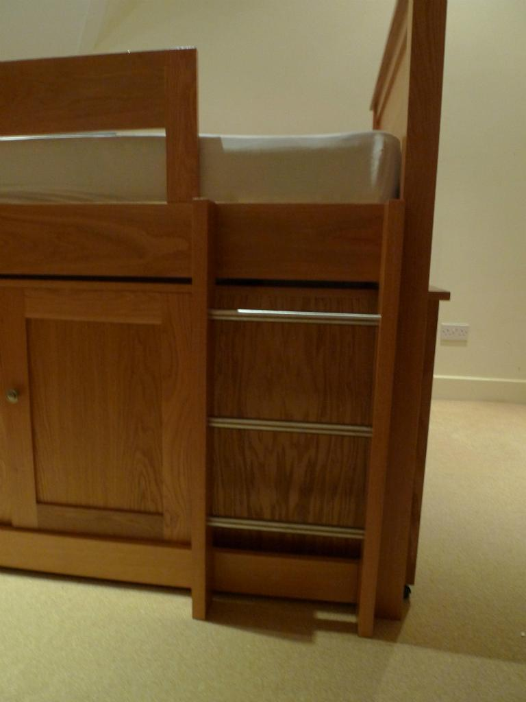 aspace kids cabin bed with cupboards drawers and slide