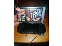 Psp with charger and grand theft auto