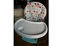 Hardly used babies'r'us highchair for sale for £15. Foldable and comes with attached harness.