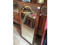 Mahogany Mirror with lovely carved Detail . In good condition . With brackets to fix to wall.