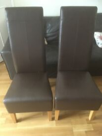 2 high back brown faux leather chairs for sale