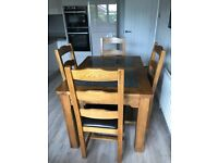 Beautiful Solid Medium Oak Dining Table with granite inserts and 4 solid oak leather seat chairs