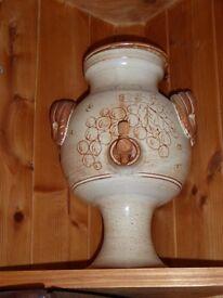 1960s pottery wine dispenser.