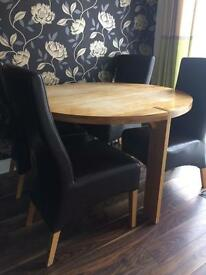 Round dining table and 4 brown leather chair