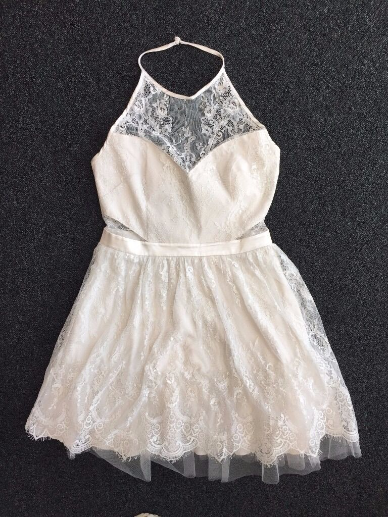 "Ariana Grande for Lipsy DressSize 10White Lace Party Prom Dressin Salford, ManchesterGumtree - I have to sell this gorgeous Ariana for Lipsy dress as unfortunately its a bit too short on me (Im 5""11). The white lace is perfect for spring/summer and would also make a nice prom dress. Size 10, still with tags. High halter neck with button..."