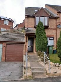 Lovely 2 bed end terrace house with driveway, garage and garden