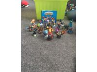 20 Skylanders figures and book