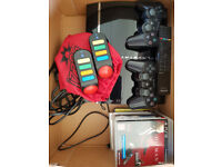 Playstation 3, 2 controllers, and some games.