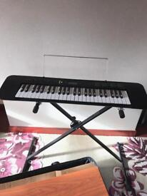 Casio Keyboard, stand, bag and books