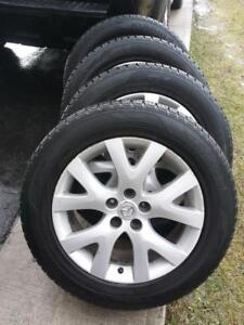 MAZDA CX5  KUMHO  HIGH PERFORMANCE ' H ' RATED ALL SEASON TIRES 235 / 60 / 18 ON FACTORY OEM ALLOY WHEELS.