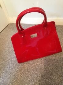 Red patent hand bag
