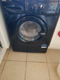 Used black washing machine