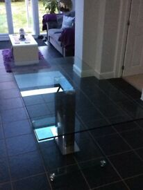Fab tempered glass dining table with chrome centre legs