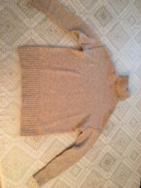 Woman's knitted high neck jumper