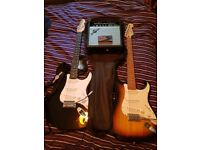 2 electric guitars, auto tuner, practice amplifier, 1 case and some accessories
