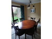 Traditional mahogany dining table with 6 upholstered chairs