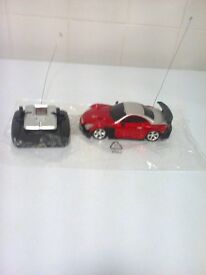 red & silver remote control car takes 3 AA batteries