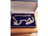 9CT GOLD CURB LINK CHAIN 35.4g