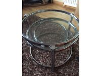 Round glass & chrome coffee table very heavy 4 sections spins out back in for storage