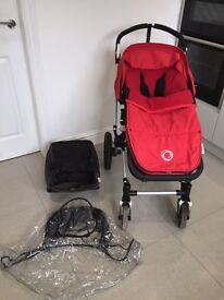 Bugaboo cameleon pushchair with red bugaboo foot muff.