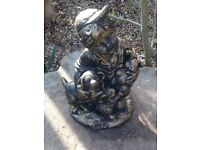 Little boy with puppies statue