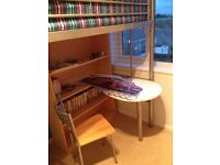 Metal framed high bed with desk, bookcase, wardrobe and chair
