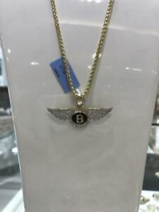 10k Yellow Gold Bentley pendant With 0.54ct Of Diamond
