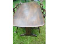 Ercol elm refectory table & 4 chairs